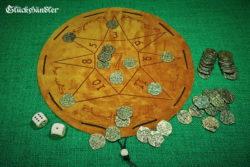 Glückshaus als Stern aus Leder - Beutelspiel mit 50 Spielmünzen.