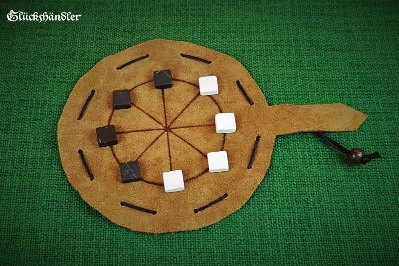 Mu Torere Spiel aus Leder mit vier Marmorsteinen - schwarz und weiß.