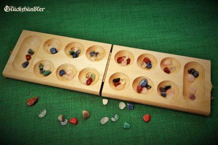 Kalaha-Mancala open with gemstone game pieces 1